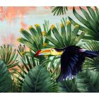 In the jungle. Toucan. Green plants.