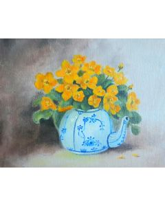 Flowers in a blue and white teapot