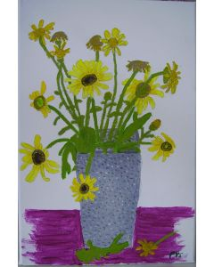 Yellow flowers in a grey vase.