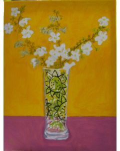 Small white flowers in a glass flowered vase.