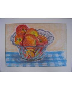 Apples in a glass fruit bowl.