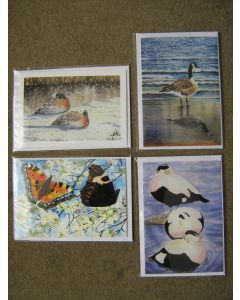A set of four greetings cards