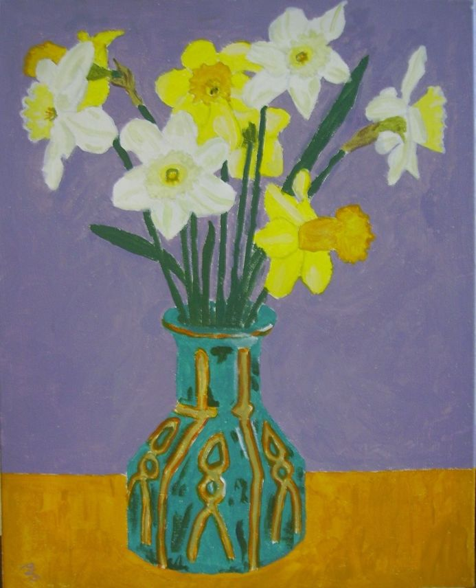 Coloured daffodils in green patterned  vase.