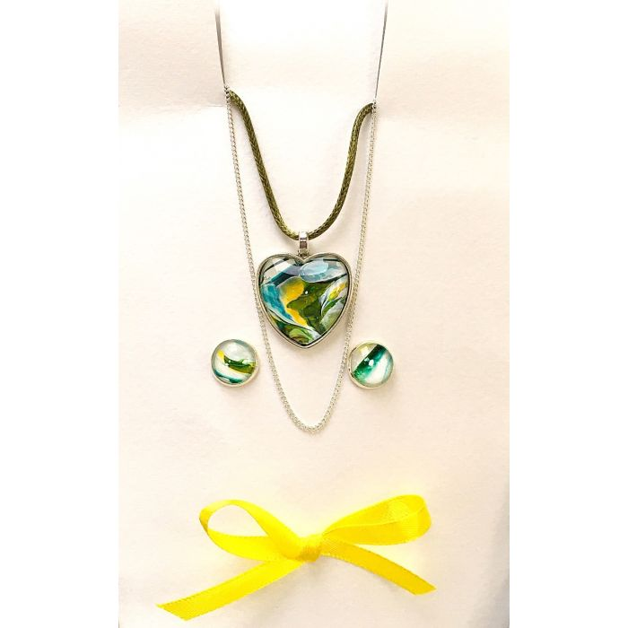 Fluid art heart shaped pendant necklace and earring set which includes two neck cords.