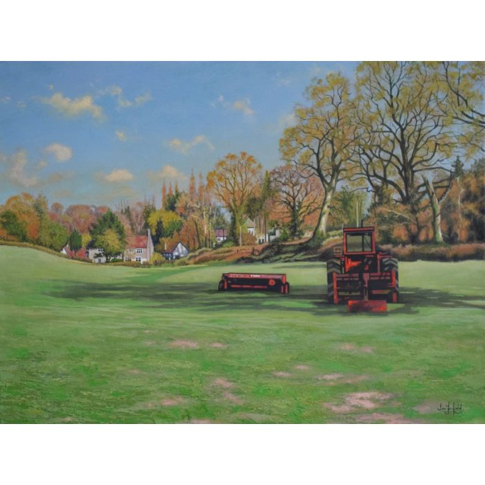 The Red Tractor in a Field