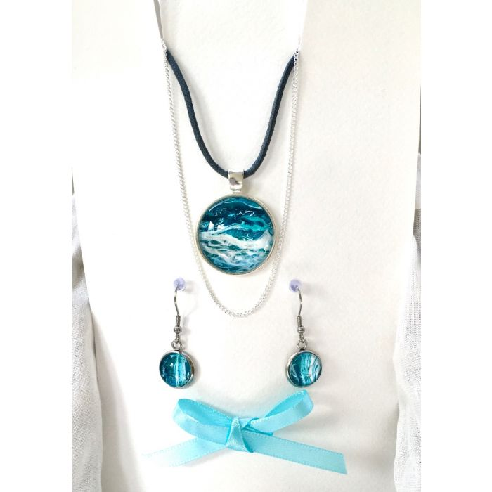 Fluid art pendant necklace and earring set which includes two neck chains