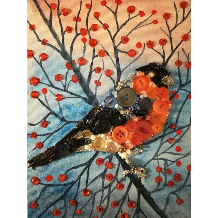 Bullfinch collage mosaic on a branch with red berries