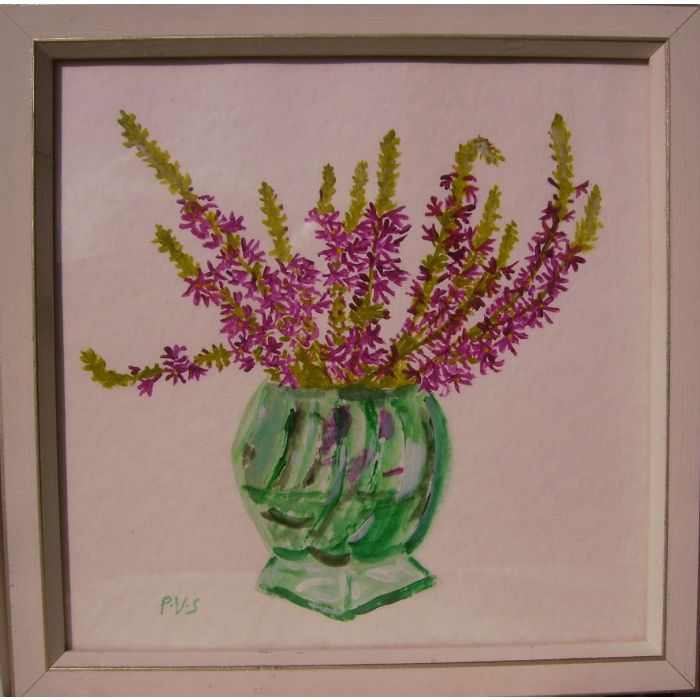 Mauve flowers  in a green glass vase.