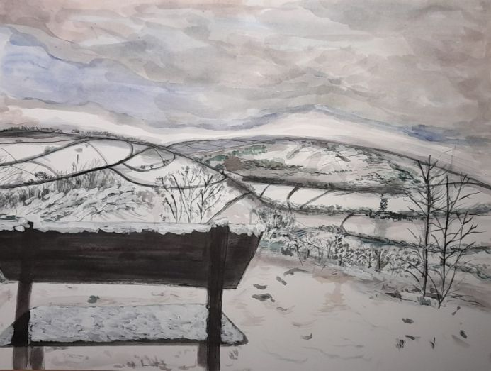Snowy Hilly View With An Empty Bench