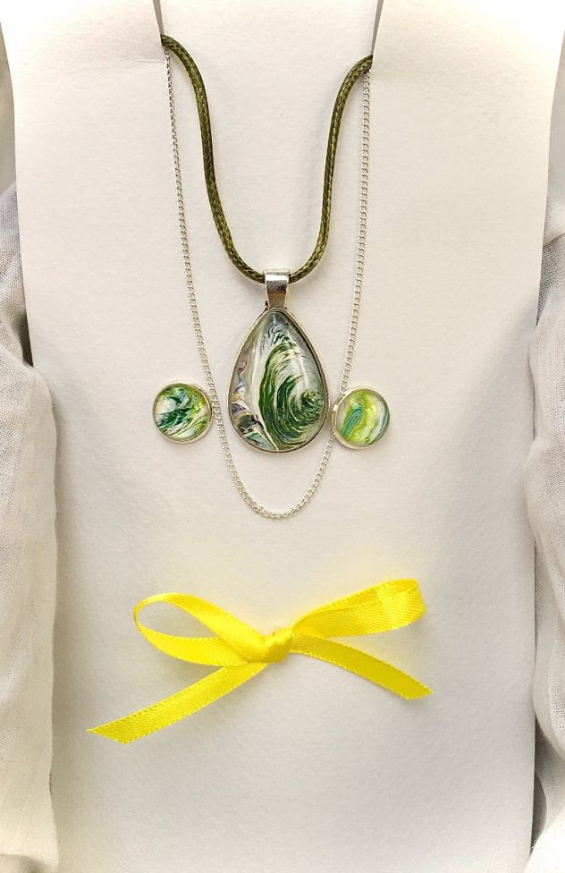 Fluid art pear shape pendant necklace and earring set which includes two neck chains