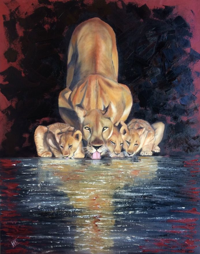 Lioness with Cubs by the water