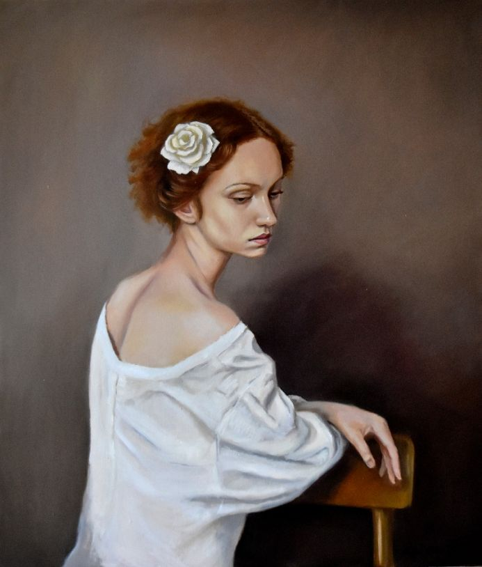 Portrait with a white rose in the hair
