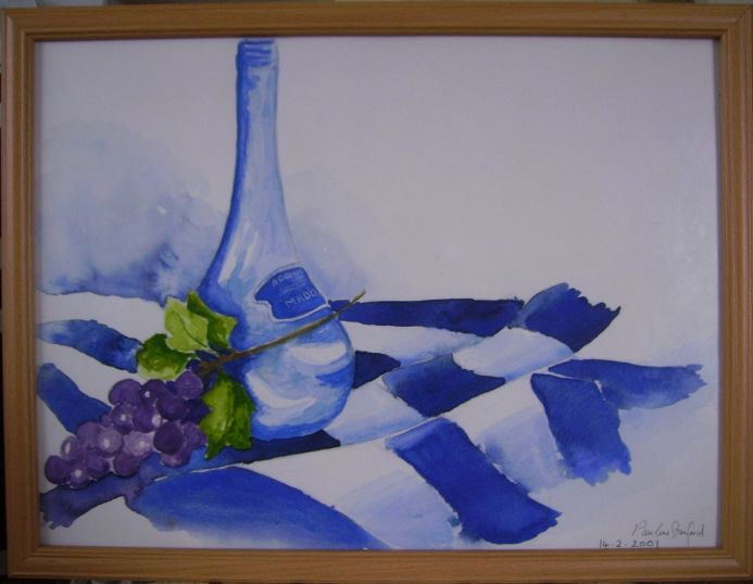 A Blue bottle with a bunch of grapes