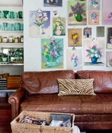 Gallery wall in a home using picture rails